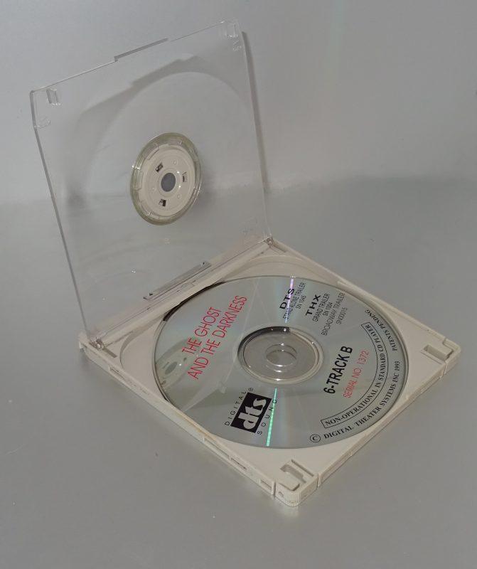 Un disque et sa cartouche ouverte